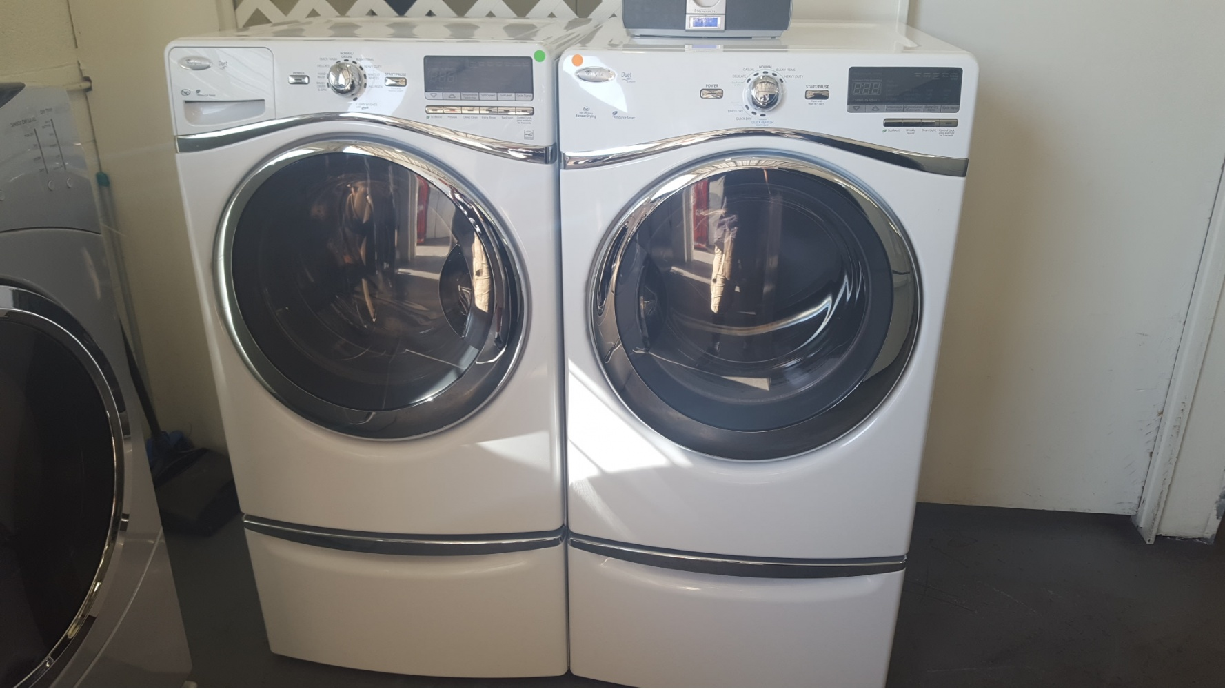 Whirlpool Duet White Front Load Washer And Gas Dryer On